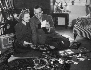 David Niven with his first wife, Primmie, looking through photos of his war years.
