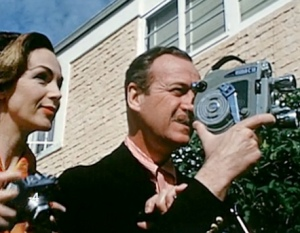 Hjordis and David Niven with cameras, 1955