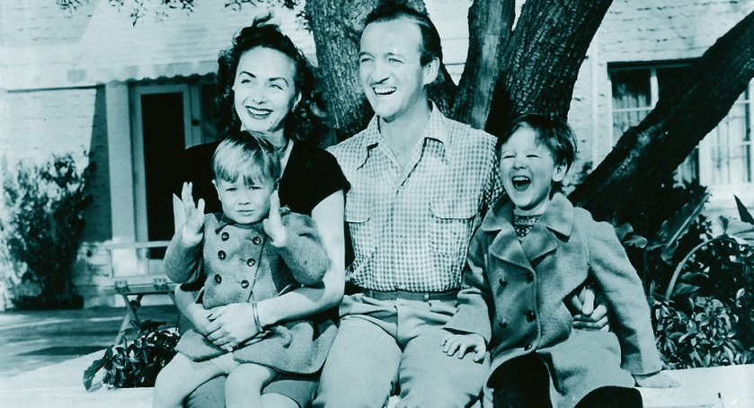David Niven with his new family outside The Pink House, 1948