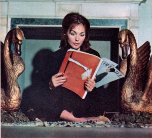 Hjordis Niven reading the March 1960 edition of L'Officiel fashion magazine.