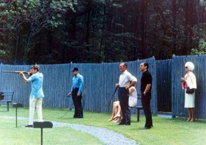 John F. Kennedy skeet shootiing, while HJotrdis watches from a safe distance. 30th May 1963