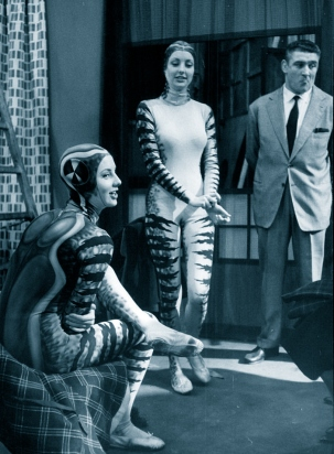 Pia and Mia Genberg in frog costumes, with actor / minder Lucien Fleurot. 1961