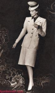 Hjordis Genberg photographed against a Persian carpet, for NK Franska. April 1944.