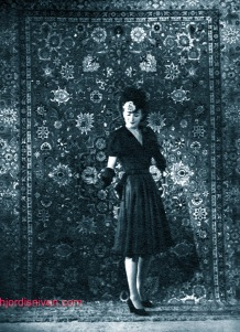 Hjordis Genberg photographed against a Persian carpet, for NK Franska. April 1944.