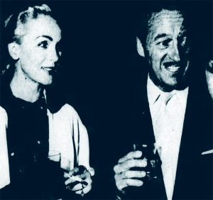 Hjordis and David chat at a cocktail party, November 1956