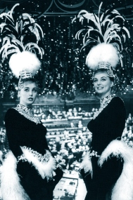 "Pia and Mia Genberg perform a parody of The Kessler Twins ' ""Pollo e Champagne"" at the Parioli Theatre, Rome. For the movie 'Scanzonatissimo', 1963"