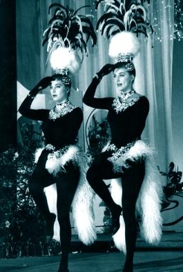 "Pia and Mia Genberg perform a parody of The Kessler Twins ' ""Pollo e Champagne"" at the Parioli Theatre, Rome. For the movie 'Scanzonatissimo', 1963"