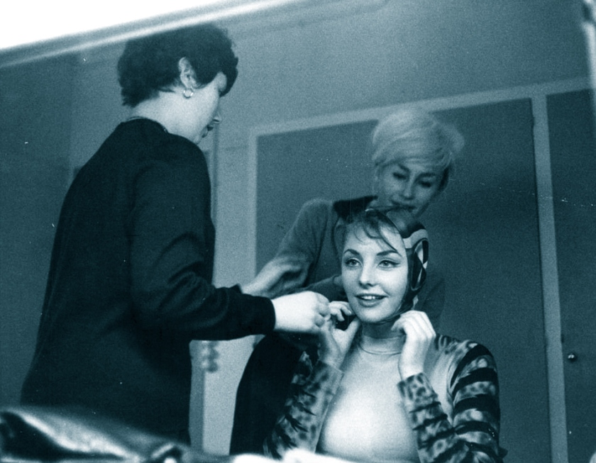 Pia Genberg being fitted into a frog costume, 1961