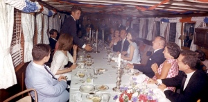 JFK's birthday party on The Sequoia. David Niven is sat opposite the president, beside The First Lady. 1963. No sign of Hjordis