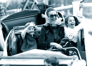 On a rollercoaster ride with Hjordis Niven. Kristina and Fiona, November 1971