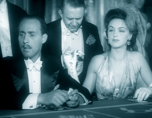 "Hjördis Genberg in the 1943 movie ""Sjätte Skottet"". A frame from her six seconds of screen-time - demanding cash from the man standing behind."
