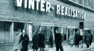 Boarded-up shop display windows in wartime Stockholm.