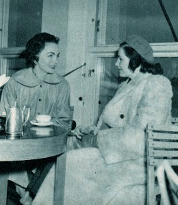 Hjördis Niven sitting in Stockholm Bromma airport with her sister Kerstin Rosén. March 1950.