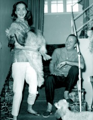 Hjördis and David Niven on The PInk House staircase, 1958