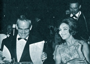 Prince Rainier and Hjordis Niven watching dancers perform at a charity bash in Monte Carlo, August 1964